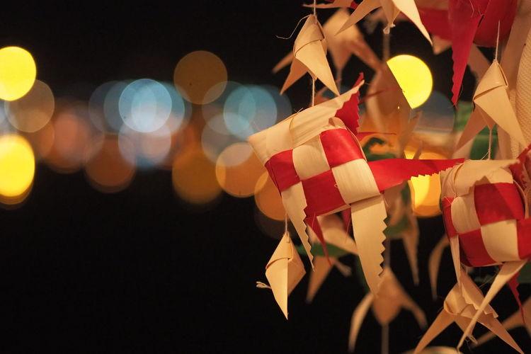 Close-up of christmas lights at night