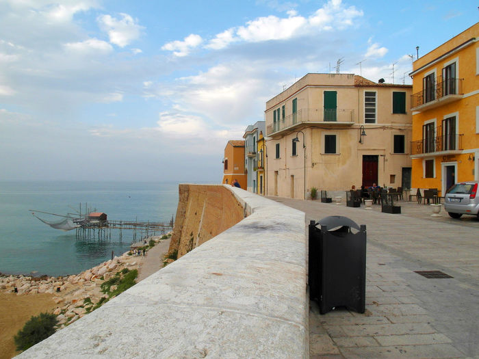 Term the beach and the trabucco Termoli  Wall Architecture Beach Building Exterior Building Story Buildings Built Structure City Cloud - Sky Day Garbage Bin Italy Lanscape Molise No People Outdoors Sky Termoli City Trabucco Travel Destination Urban Landscape