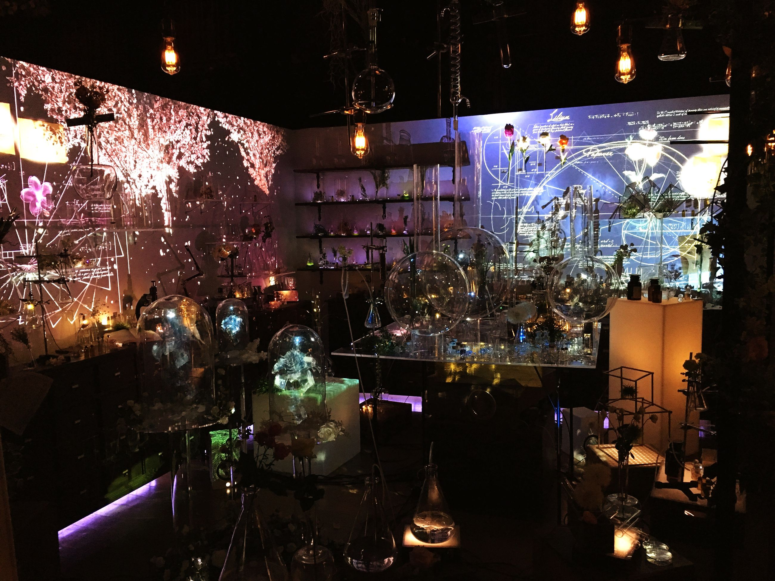 illuminated, night, indoors, lighting equipment, light - natural phenomenon, decoration, table, restaurant, built structure, hanging, celebration, electric light, electricity, no people, dark, architecture, glass - material, large group of objects, variation, chair