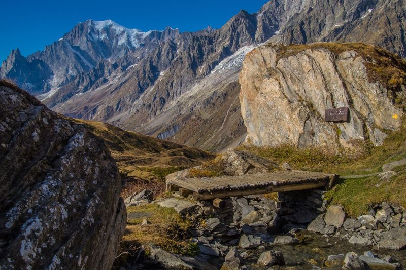 mallatra,val ferret,courmayeur,italy Mountain Mountain Range Scenics - Nature Nature Rock Solid Beauty In Nature Rock - Object Environment Landscape Day No People Land Sky Outdoors Architecture Non-urban Scene Travel Destinations Wood - Material Mountain Peak Formation