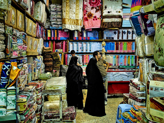 Retail  Choice Variation For Sale Real People Large Group Of Objects Market Women Shopping Two People Store Adult Abundance People Retail Display Lifestyles Rear View Arrangement Buying Small Business Sale Consumerism