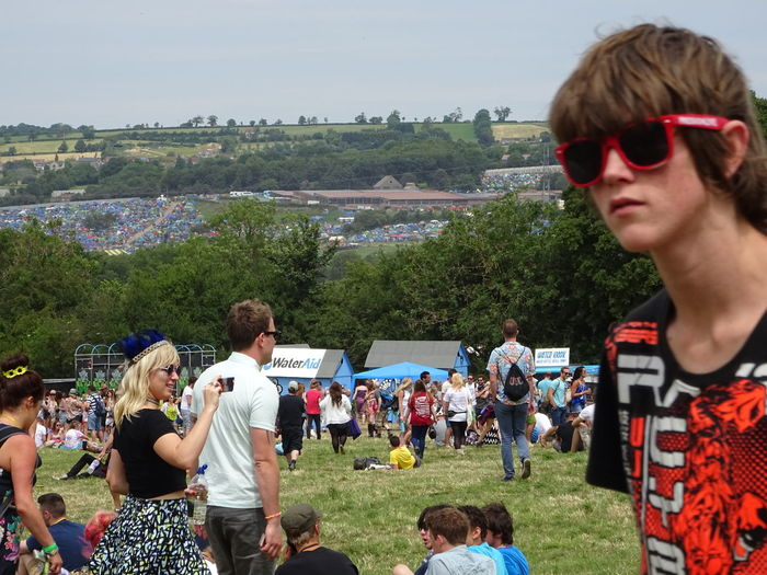 Day Field Field View Glastonbury 2014 Guy Front Right Red Sunglasses Sky Tents In The Distance Togetherness