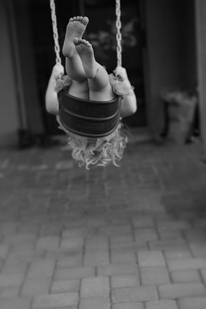 Having Fun Swinging Little Feet Black And White Fun Childsplay To Be A Kid Again