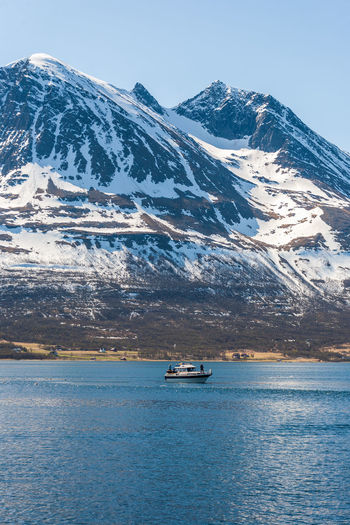 Norwegian fjord with a boat and a mountain in spring