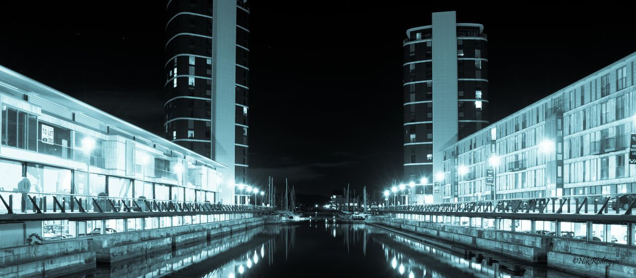 architecture, night, built structure, illuminated, building exterior, transportation, outdoors, city, modern, waterfront, travel destinations, no people, sky, water