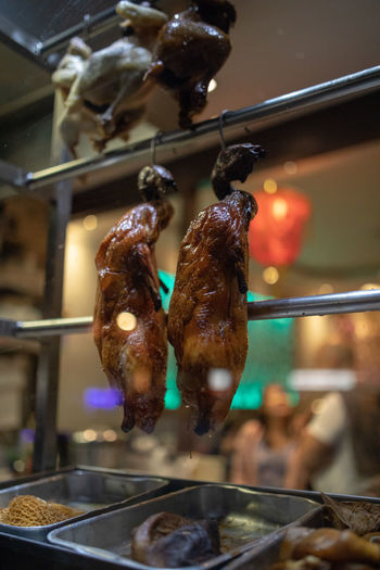 Close-up of meat hanging in kitchen at restaurant