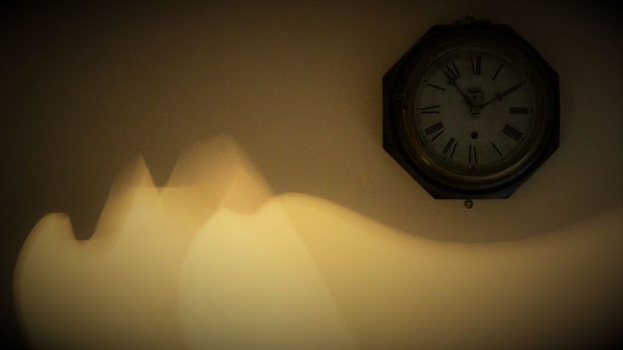 Close-up of clock hanging at night