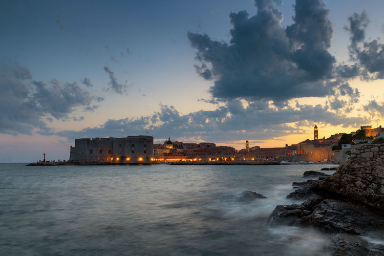 Dubrovnik, Croatia Sky Water Cloud - Sky Building Exterior Architecture Built Structure Sea Sunset Nature City Beauty In Nature Dusk Scenics - Nature Waterfront Outdoors Building Beach Seascape Dubrovnik Dubrovnik, Croatia Croatia Coast City Wall Heritage