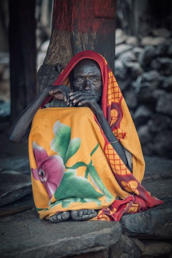 Old Age Portrait Of A Man  Portraits African Village Ethiopia Africa Tribal Ethiopian Photography 🇪🇹 Travel Travel Destinations No People Art And Craft Close-up Multi Colored Still Life Creativity Focus On Foreground Craft Outdoors Textile Orange Color Shoe Representation Clothing Shoelace Wood - Material Floral Pattern Red Toy Day