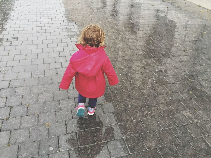 Rear view of girl wearing raincoat
