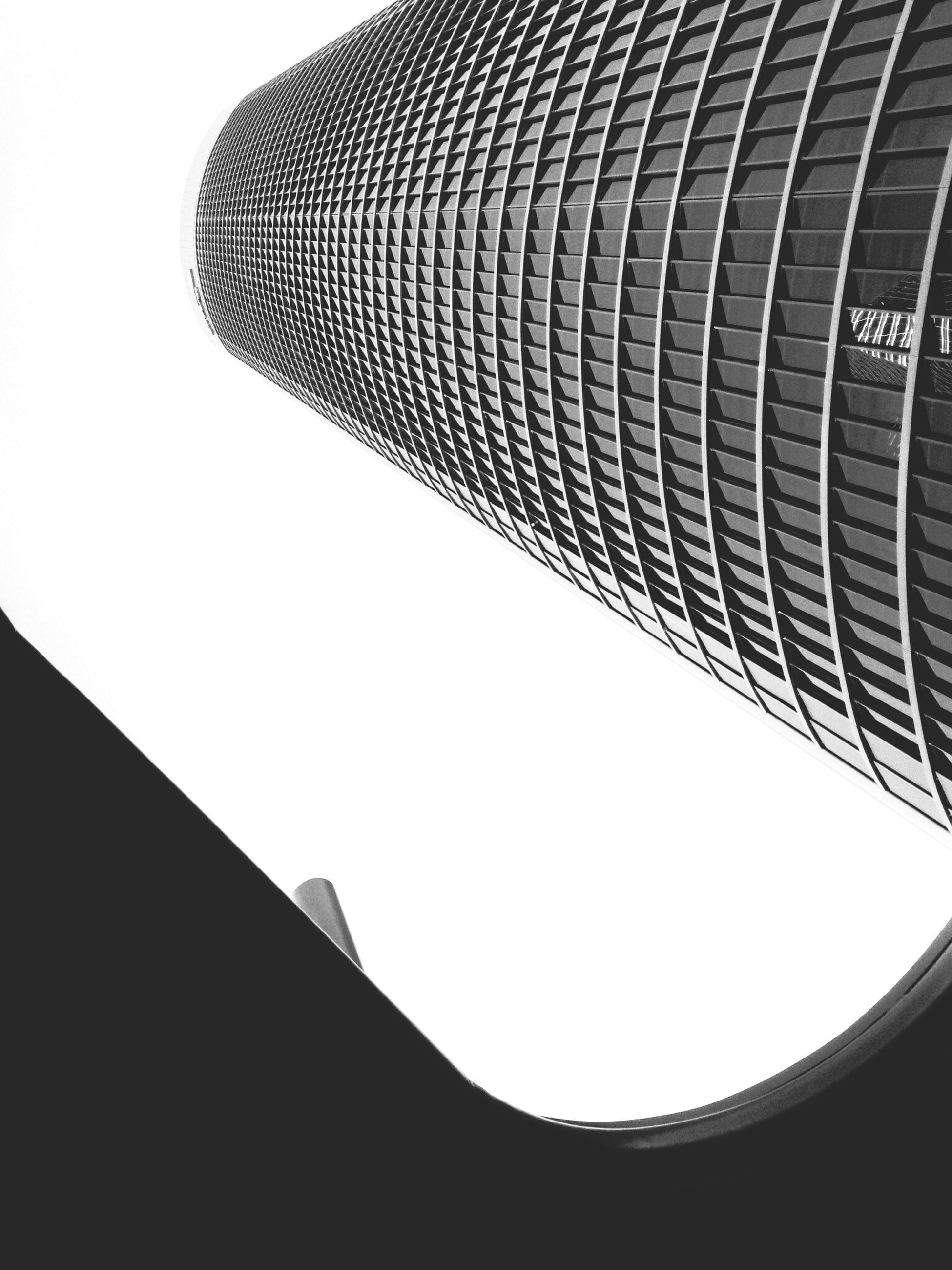 architecture, low angle view, built structure, building exterior, modern, clear sky, tower, tall - high, city, skyscraper, building, office building, sky, no people, day, copy space, outdoors, directly below, pattern, architectural feature