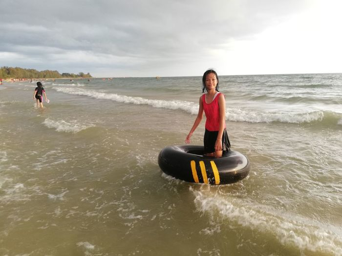 Children enjoy on summer trip 2019,หาดเจ้าหลาว Achi2019 Sea Water Sky Leisure Activity Cloud - Sky Beach Lifestyles Land Real People Beauty In Nature People Sport Nature Horizon Young Adult Day Motion Horizon Over Water Three Quarter Length Outdoors