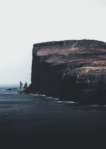 The legend of Risin og Kellingin. Location: Risin og Kellingin, Faroe Islands Equipment: Fujifilm X-T2 + XF18-55 F2.8-4. EyeEm Best Shots EyeEm Selects Risin Og Kellingin Beach Beauty In Nature Clear Sky Cliff Day Faroe Islands Land Nature No People Outdoors Rock Rock - Object Rock Formation Scenics - Nature Sea Sky Solid Stack Rock Tranquil Scene Tranquility Water Waterfront