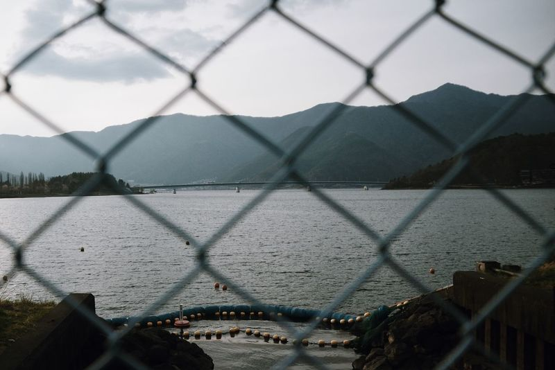 Japan Bridge - Man Made Structure Chainlink Chainlink Fence Close-up Day Lake Lake View Lakeshore Metal Mountain Mountains Nature No People Outdoors Protection River Safety Security Sky Water