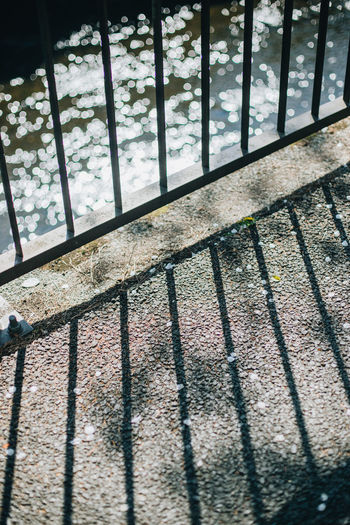 High angle view of railing by window