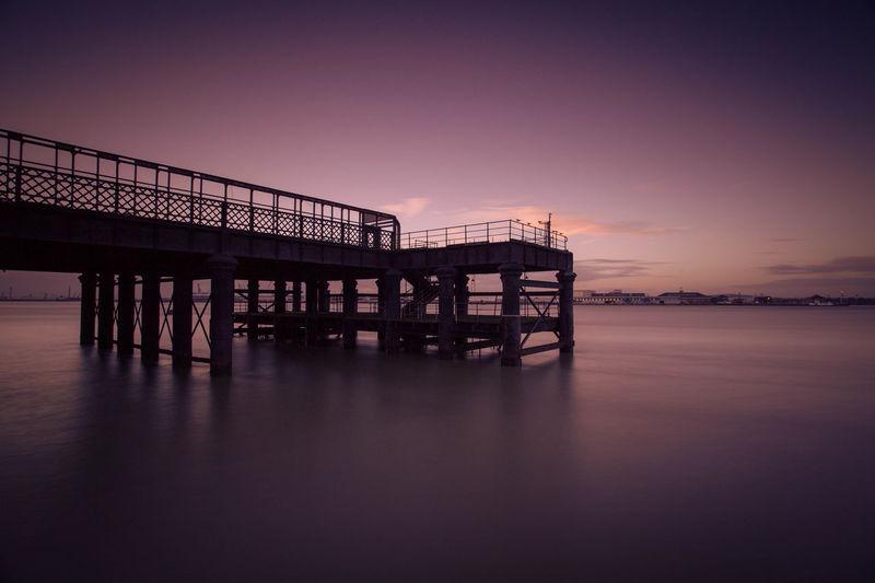 Side view of bridge at calm sea