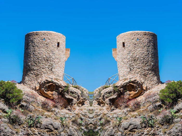 Old signal towers and watchtowers or defensive towers in Spain. Mallorca Pirate Tower Ancient Architecture Blue Built Structure Clear Sky Close-up Day History No People Outdoors Singnal Tower Sky Tower Watchtower