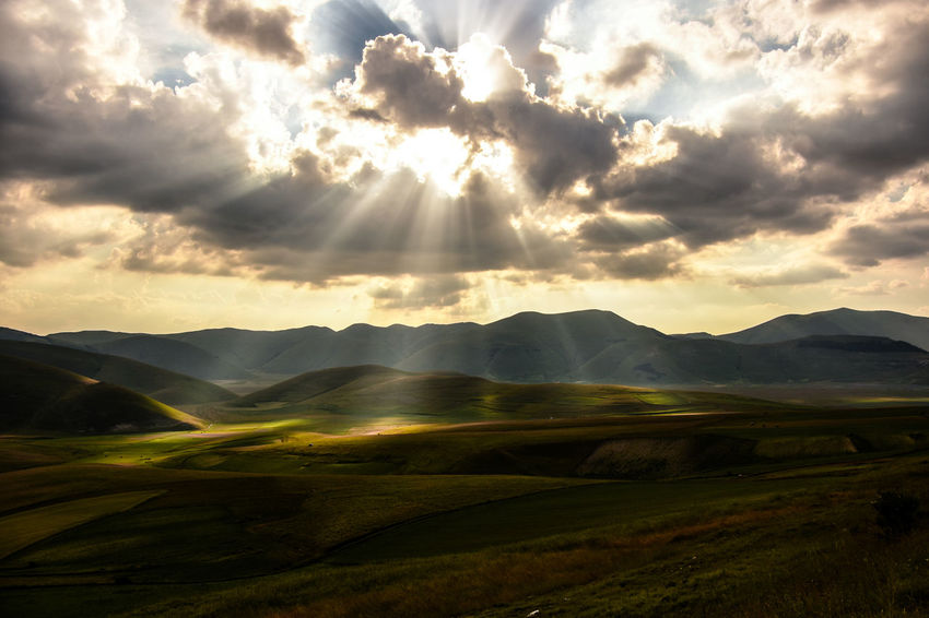 Light explosion. Castelluccio Di Norcia Explosion Hills Nature Sunlight Umbria, Italy Bright Clouds Explore Hillside Landscape Light And Shadow Mountain Range Outdoors The Great Outdoors - 2018 EyeEm Awards The Traveler - 2018 EyeEm Awards