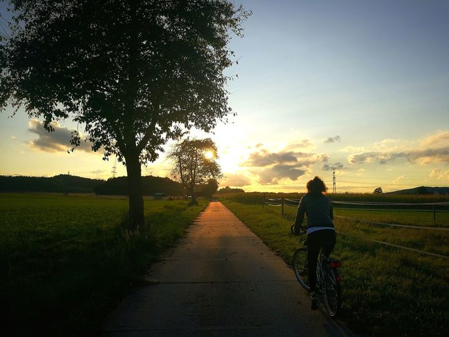 riding into sunset Sunset People Agriculture Tree One Person Only Women Cloud - Sky Adult Nature Sky Rural Scene Full Length Landscape Human Body Part Adults Only Outdoors One Woman Only Grass Beauty In Nature Day