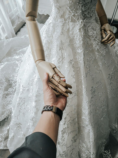 High angle view of woman holding hands