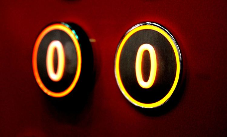 Close-up Double Zero Ground Floor Illuminated Lift Lift Buttons Number Red Background Travelling Home For The Holidays