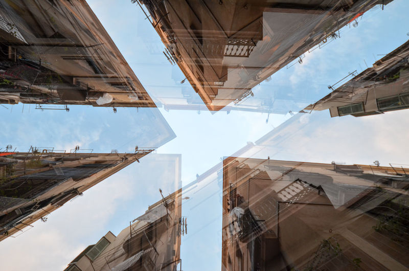 Multiple exposure of buildings against sky