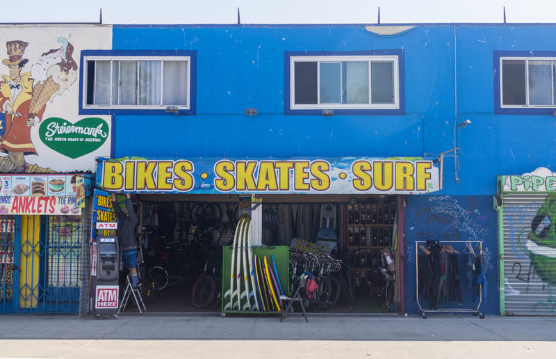 Athletics Surf Architecture Awning Beach Bikes Blue Building Exterior Built Structure City Communication Day No People Outdoors Skate Store Text Western Script