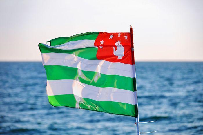 Abkhazian flag and black sea Abkhazia Abkhazian Flag Water Sea Politics And Government Patriotism Flag Beach Politics Horizon Over Water Sky National Icon Symbolism National Flag Waving The Traveler - 2018 EyeEm Awards The Great Outdoors - 2018 EyeEm Awards
