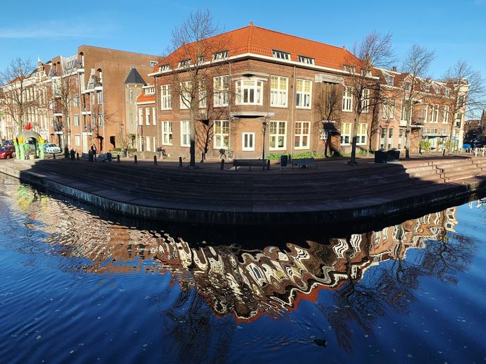 Architecture Built Structure Building Exterior Water Building Reflection Waterfront Incidental People Residential District Canal House City Outdoors Sky Tree Row House Nature Day