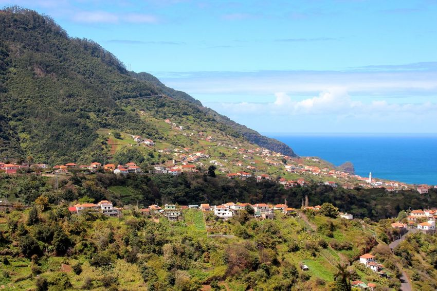 Levada do Castelejo e Lombo Grande, Porto da Cruz. View of Faial Architecture Beauty In Nature Blue Building Exterior Built Structure Coastline High Angle View Horizon Over Water House Idyllic Madeira Madeira Island Mountain Nature Scenics Sea Sky Town Tranquil Scene Tranquility Tree Water