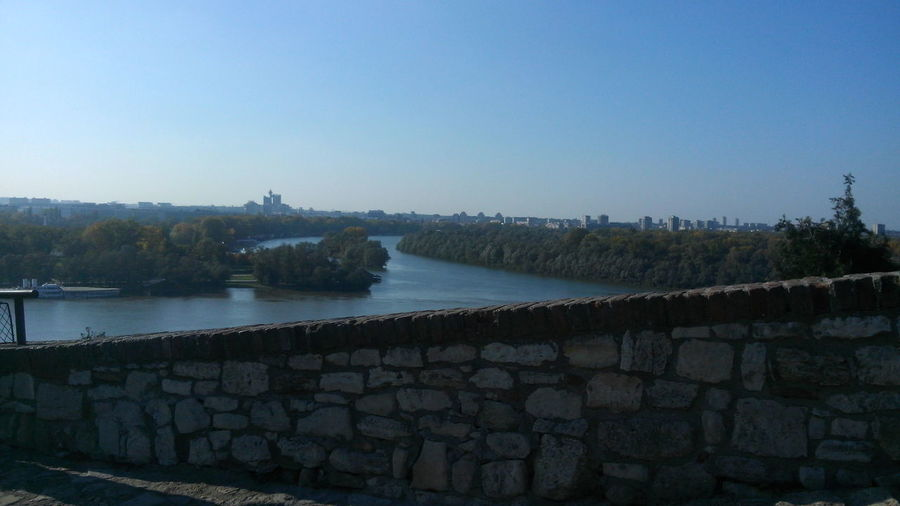 Architecture Beauty In Nature Belgrade Rivers View From Kalemegdan Fortress Building Exterior Built Structure Canon Castle Clear Sky Copy Space Danube River Day Fort Groyne History Landscape Nature No People Outdoors Retaining Wall Sava River Sky Stone Wall Tranquil Scene Tree Water