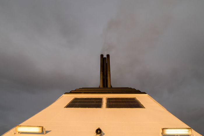 Close-up view of a chimney of a passanger ship directly below Black Burn Chimey Close-up Cloud Copy Space Dark Directly Below Energy Ferry Journey Nautical Vessel Passenger Ship Pollution Scary Sea Sky Smog Smoke Tourist Toxic Substance Transportation Travel Vacations Water