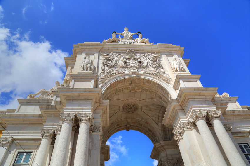 Famous Commerce Plaza Arches and monuments in Lisbon historic center Praça De Comércio Commerce Plaza Lisbon Portugal Lisboa Sightseeing Hitorical Place Historic Center Nobody Monument Sculpture Travel Destinations Famous Destination Attraction Square Statue King Jose I