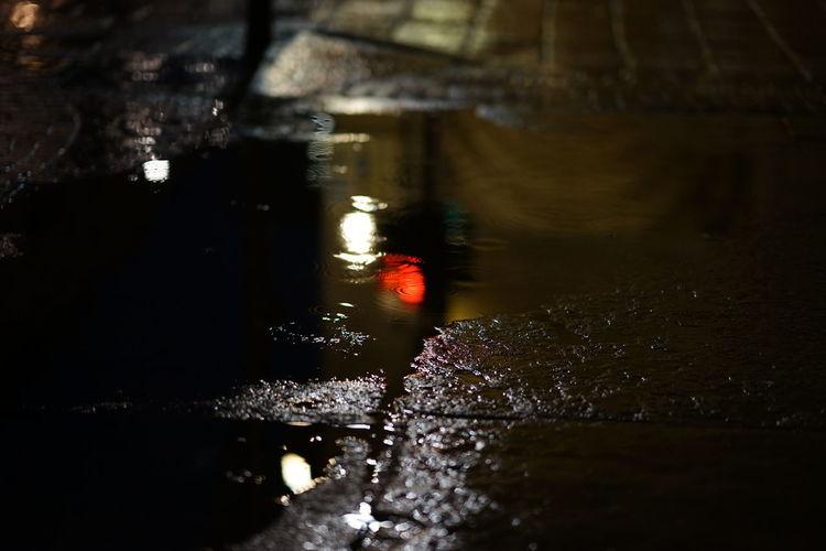 Reflection on the cubblestone Streetphotography Urban Night Street Sidewalk Water Puddle Reflection Close-up Refraction Rippled Rainfall Rain