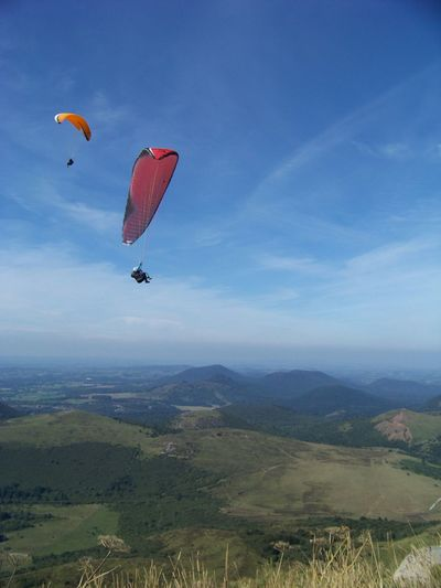 People paragliding over mountain