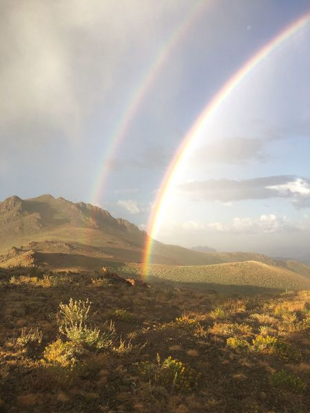 Rainbow Double Rainbow Scenics Beauty In Nature Mountain Landscape Sky Outdoors Mountain Range Cloud - Sky Hunting Tranquil Scene Nature Tranquility Idyllic No People Adventure