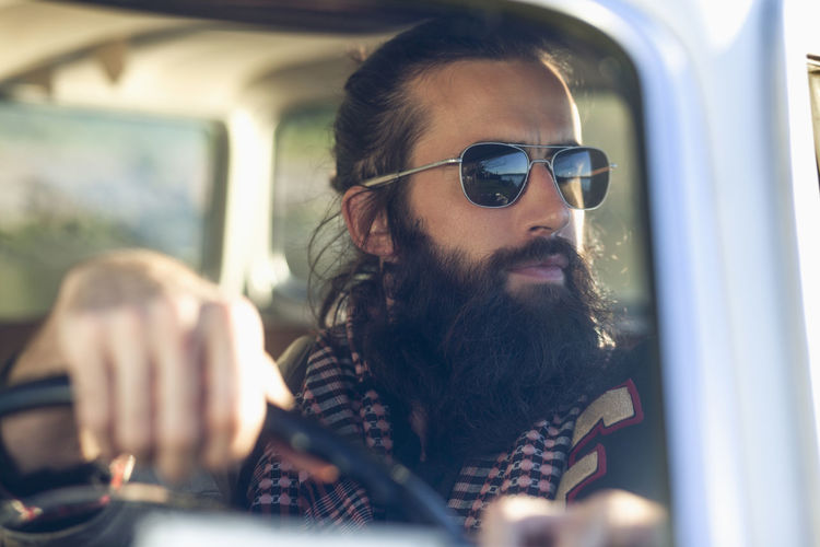 Portrait of mature man sitting in car