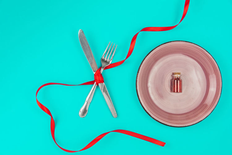 High angle view of decoration on table against blue background
