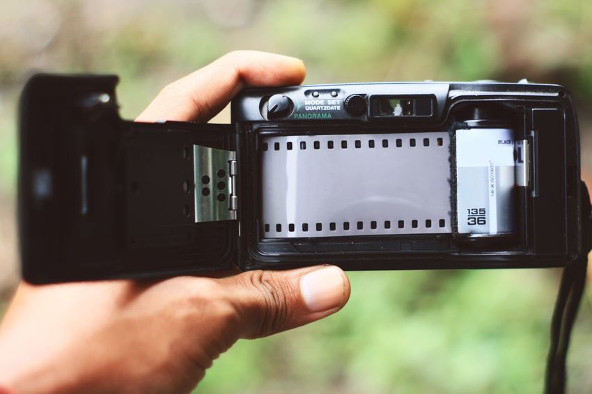 analog pocket camera 35mm 35mm Film Analog Camera Camera - Photographic Equipment Camera Film Close-up Day Film Industry Filming Human Body Part Human Hand Modern Outdoors Photography Themes Pocket Camera Pocketphotography Rolled Up Technology
