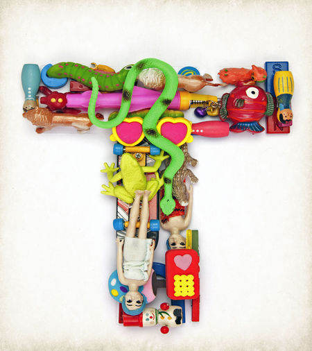 Capital letter T made from cheap toys Kindergarten Letter T Toys In The Attic Typography Abundance Capital Letter Cheap Toys Close Up Close-up Collection Creativity Detail High Angle View Large Group Of Objects Multi Colored No People Plastic Plastic Toys Preschooler Still Life Studio Shot Text Toy Toy Photography Western Script
