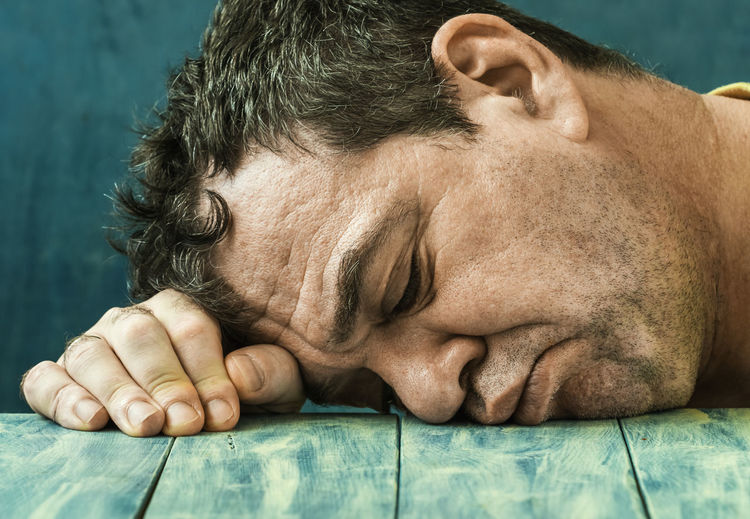 Close-up portrait of a man sleeping