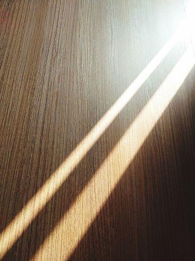 High angle view of shadow on hardwood floor