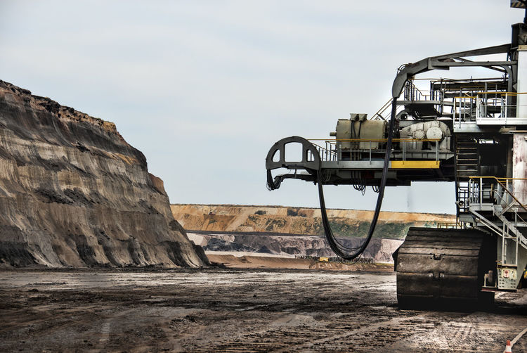 Coal mining in opencast mining. Monster machines. Day Outdoors Brown Coal Surface Mining Area Open-cast Mining Excavator Landscape Coal Machine Industry Monster Machines