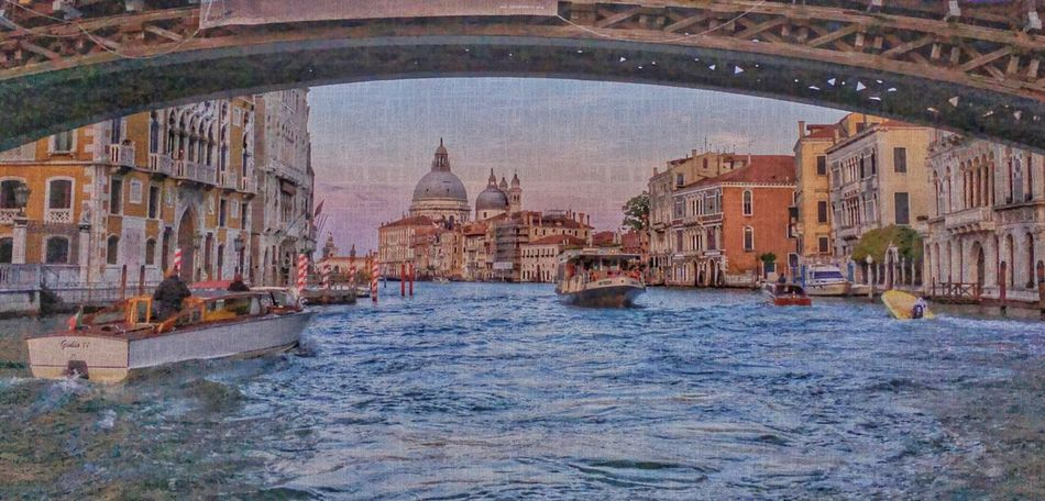 View of Grand Canal from under a bridge in Venice Venice Canals
