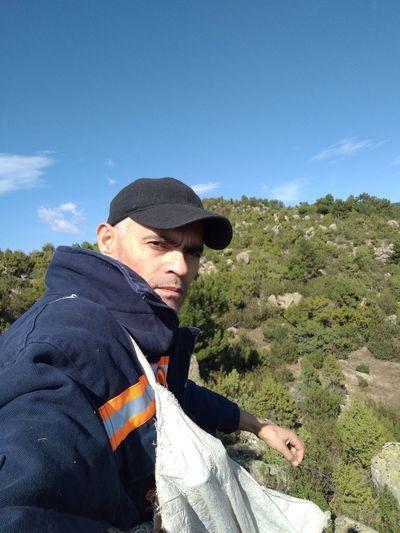 Portrait of man wearing against mountain