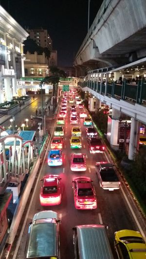 Here is Bangkok, Thailand. Illuminated City High Angle View Night Travel Destinations Futuristic Outdoors Cityscape Traffic Lights Trafficinthecity Trafficincity Traffic Traffic Light  Trafficlight Traffic Jam In Bangkok ,Thailand Bangkok Thailand Connected By Travel