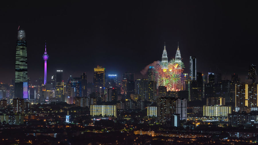 Kuala Lumpur cityscape skyline on the night of the 61st Malaysia's National Day a few minutes with the firework display at the Petronas Twin Towers Malaysia Day Architecture Building Building Exterior Built Structure City Cityscape Crowded Financial District  Firework Display Illuminated Landscape Light Modern Nature Night Nightlife Office Building Exterior Outdoors Sky Skyscraper Spire  Tall - High Tower Urban Skyline