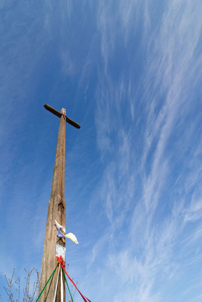 Old wooden high cross on the blue sky with cirrus clouds, low angle view, photo taken in Poland, Europe Belief Cloud - Sky Cross Day High Jesus Large Group Of Objects Low Angle View No People Poland Religion Sky Symbol Tall Wood Wooden Copy Space Copyspace