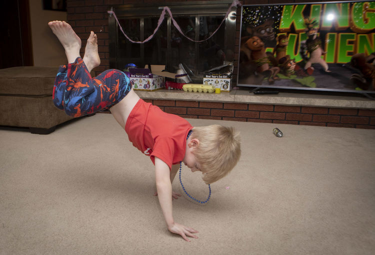 A five-year-old boy dances on New Year's Eve at his home. Childhood Child One Person Full Length Real People Indoors  Lifestyles Leisure Activity Lying Down Girls Home Interior Boys Females Furniture Relaxation Casual Clothing High Angle View Innocence Dancing Break Dancing  Celebration New Years Eve New Years Eve 2019 New Year's Eve