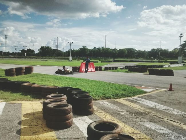Kartings on the track. Cloud - Sky Outdoors Grass Sky Karting Track Race Racing Racetrack Racecar Race Course Racing Cars Tires Tire Track Speed Speed Limit Sunny Sunny Day Race Car Need For Speed Fast Fast Cars HDR Velocity Velocidad Go Higher